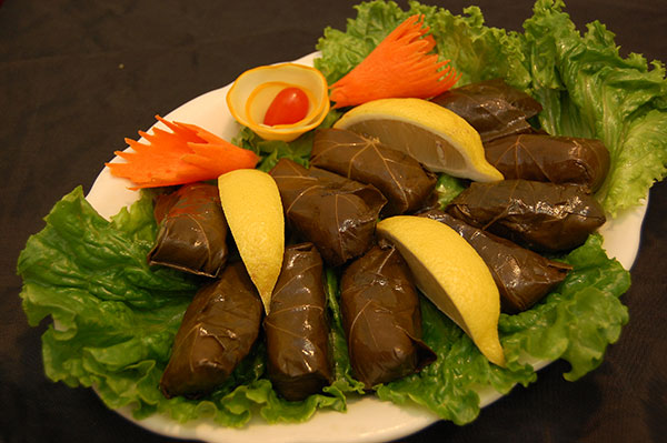 Sarma: Grape Leaf, Rice, Dill, Mint, Cilantro, Parsley, Basel, Onion, Tomato & pepper paste, Olive Oil.